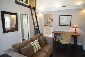 The front room of The Bungalow offers a beautiful desk, comfortable couch, cozy fireplace and flat screen TV.
